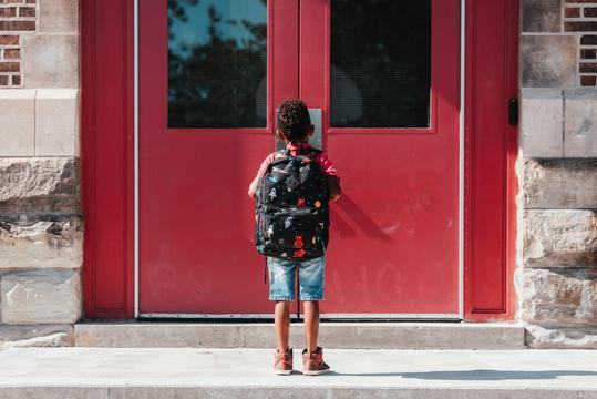 Child at school door
